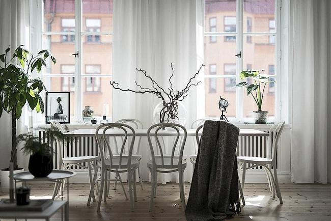 Căn hộ màu trắng rộng 62m2 chẳng hề nhàm chán nhờ cách trang trí có tính thẩm mỹ cao - Ảnh 2.