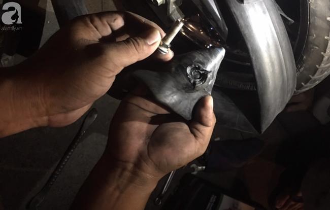 Người dân từ TP.HCM về quê ăn Tết cẩn thận mang hoạ: Mới 2 ngày phát hiện nhiều ký đinh trên quốc lộ 1A - Ảnh 4.