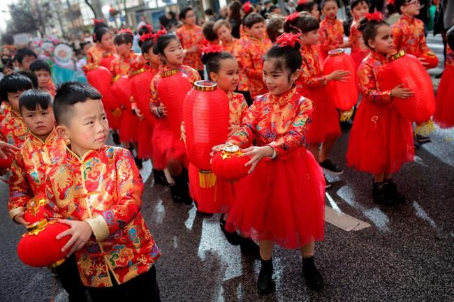 Hàng triệu người trên thế giới chào đón Tết Nguyên Đán Canh Tý 2020: Trung Quốc có một dịp Tết khác lạ, Việt Nam lung linh trên báo nước ngoài - Ảnh 13.