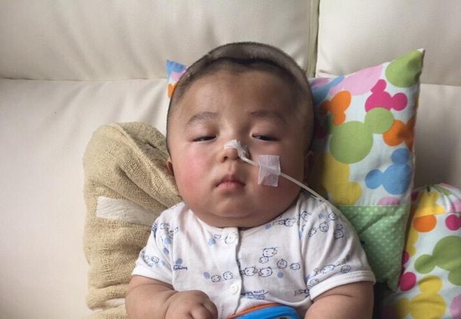 Tin vui: Bé Phạm Đức Lộc được bác sĩ cho về Việt Nam đón sinh nhật một tuổi - Ảnh 1.