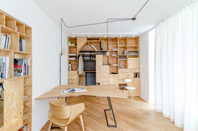 Căn hộ 120m² vừa là nơi ở vừa là văn phòng làm việc đẹp hút hồn nhờ khéo léo thiết kế kệ đựng đồ - Ảnh 7.