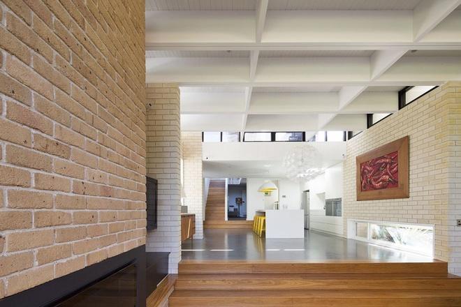 Ngôi nhà mái bằng trang trí theo phong cách hiện đại với điểm nhấn là mái nhà phủ đầy cây xanh - Ảnh 1.