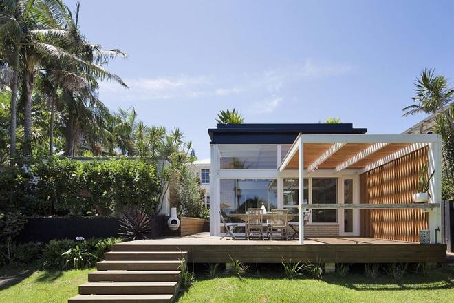 Ngôi nhà mái bằng trang trí theo phong cách hiện đại với điểm nhấn là mái nhà phủ đầy cây xanh - Ảnh 6.