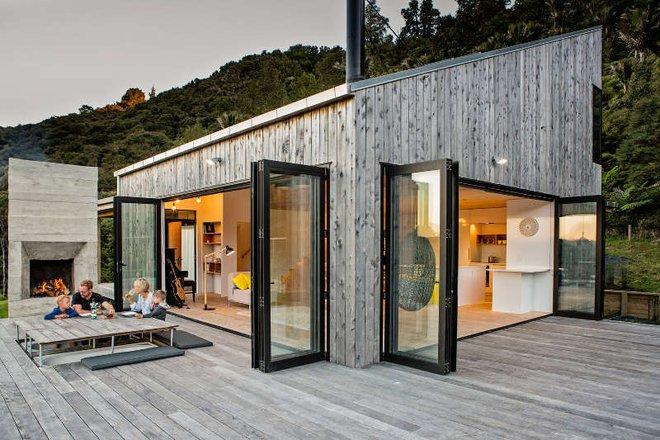 Ngôi nhà gỗ nhỏ thơ mộng bên đồi núi xanh tươi ai cũng mơ ước - Ảnh 1.