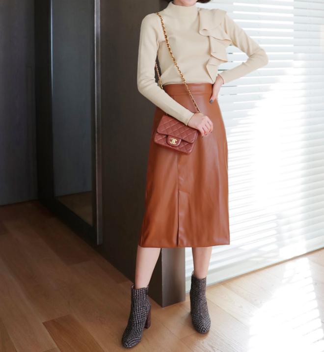 Lên đồ ấm áp cho ngày trời lạnh tăng cường với 4 kiểu chân váy chuyên dụng của mùa đông - Ảnh 13.