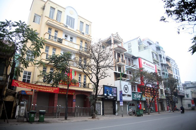 Sáng 29 Tết, nhiều tuyến phố Hà Nội đã vắng bóng người qua lại - Ảnh 9.