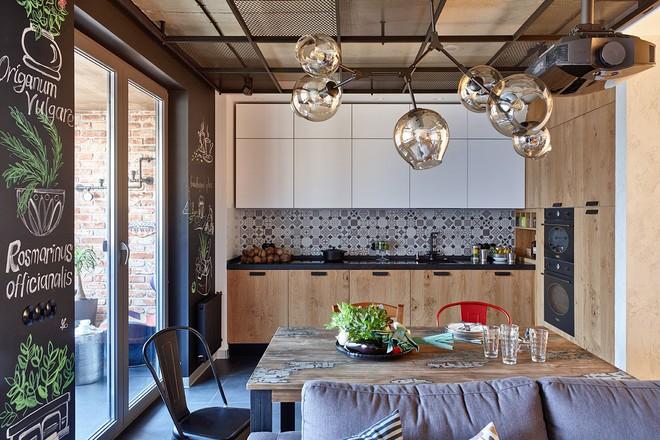 Độc đáo căn hộ 69 m2 với bức tường gạch thô, đầy màu sắc ấm áp - Ảnh 6.