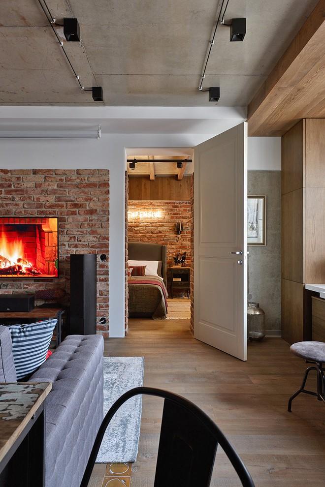 Độc đáo căn hộ 69 m2 với bức tường gạch thô, đầy màu sắc ấm áp - Ảnh 9.