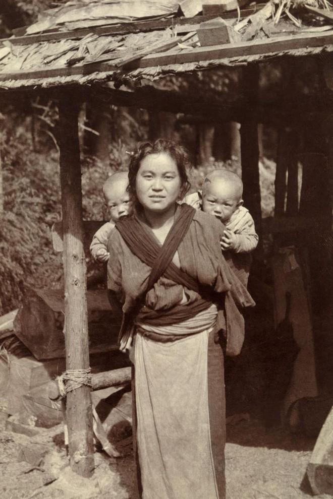 Ngày của mẹ, ngắm những bức ảnh về mẹ đẹp nhất trong suốt 100 năm qua - Ảnh 16.