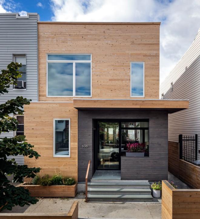 Diện tích chỉ 30m², ngôi nhà bằng gỗ dưới đây vẫn vô cùng hiện đại và bắt mắt - Ảnh 1.