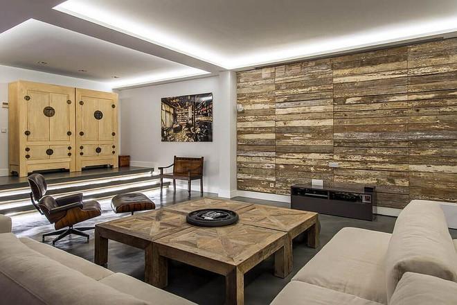 Độc đáo, lạ mắt lại vô cùng ấm áp ngay khi nhìn thấy: 10 phòng khách với thiết kế bức tường gỗ này sẽ chinh phục bạn - Ảnh 9.