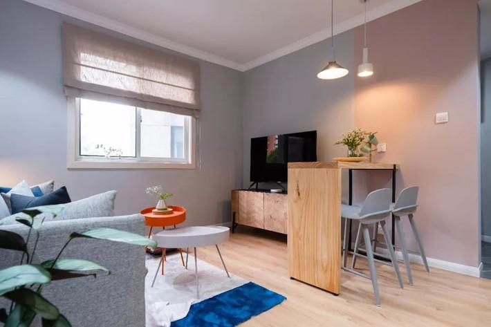 Phong cách Bắc Âu nhẹ nhàng với tông màu xanh, ghi, hồng được kết hợp vô cùng đặc biệt trong căn hộ 56m²  - Ảnh 7.