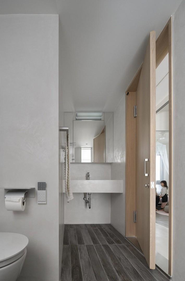 Căn hộ trung tính vui vẻ nhờ loại bỏ các bức tường tạo sự kết nối giữa các thành viên trong nhà - Ảnh 11.