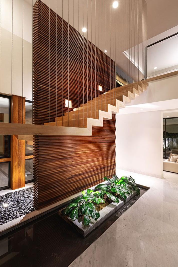 Lại thêm một không gian sống ấm cúng để bạn tham khảo có sự xuất hiện của gỗ và đá ở mọi nơi - Ảnh 15.