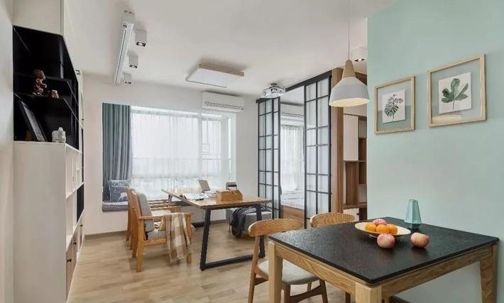 Cặp vợ chồng trẻ cải tạo căn hộ 54m² từ chật hẹp thành không gian vô cùng rộng rãi nhờ khéo thiết kế khu vực lưu trữ - Ảnh 4.