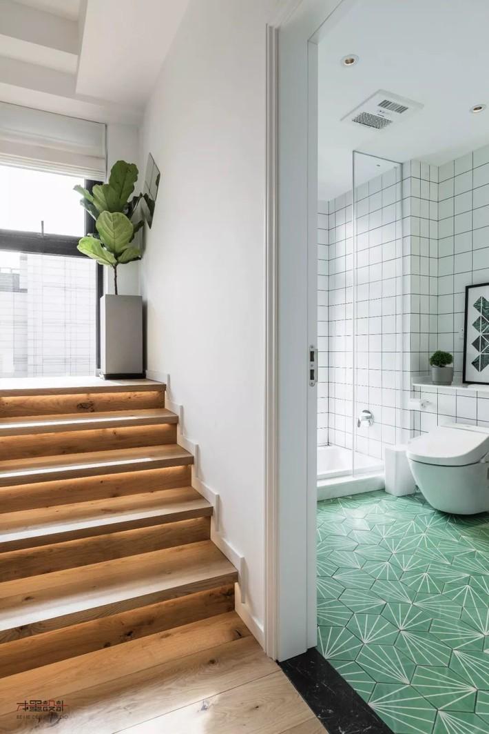 Choáng toàn tập với ngôi nhà sở hữu phòng khách chìm và không gian lưu trữ rộng lớn ẩn dưới mặt sàn bằng gỗ - Ảnh 12.