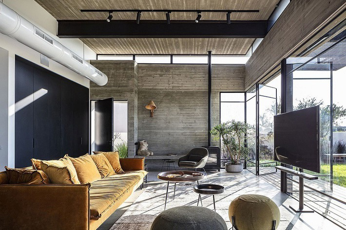 Ngắm ngôi nhà có nét thiết kế cởi mở và hiện đại nằm giữa cảnh quan đầy sự đối lập đến không tưởng - Ảnh 1.