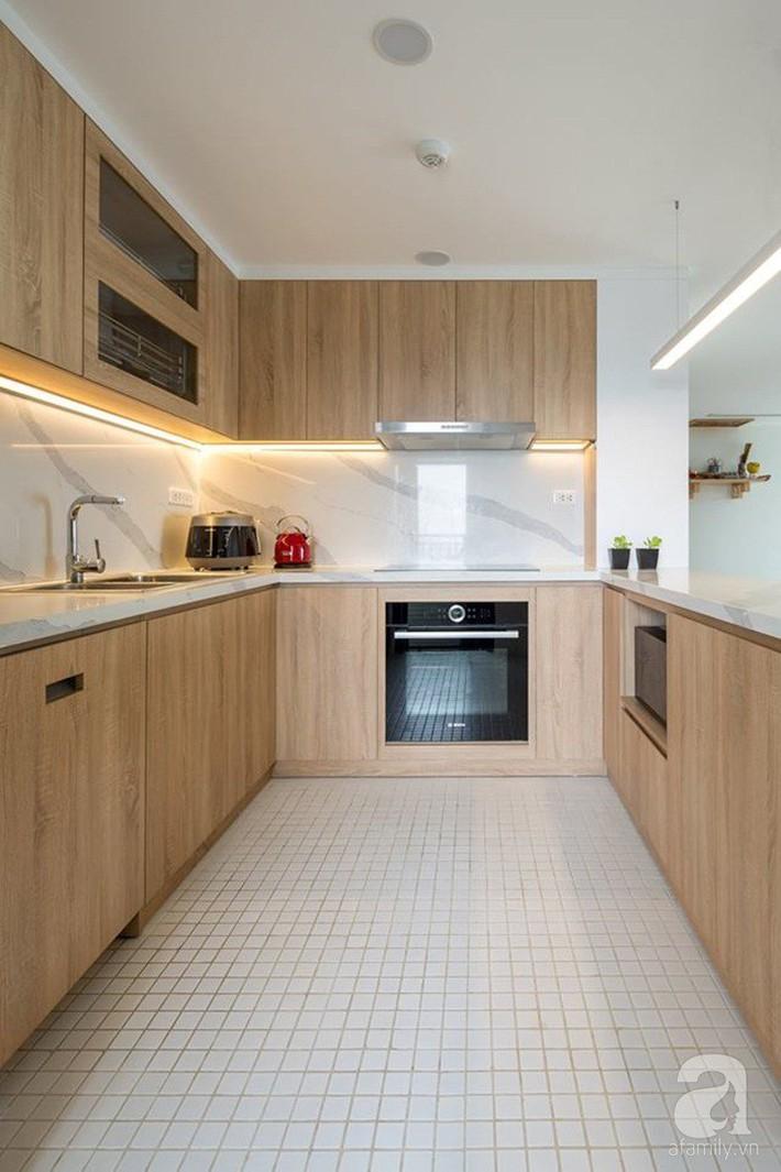 Căn hộ 120m² đẹp hiện đại, ấm cúng với màu gỗ làm chủ đạo của cặp vợ chồng trẻ mới cưới ở Hà Nội - Ảnh 11.