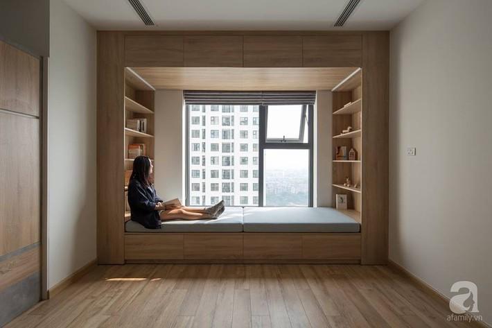 Căn hộ 120m² đẹp hiện đại, ấm cúng với màu gỗ làm chủ đạo của cặp vợ chồng trẻ mới cưới ở Hà Nội - Ảnh 13.