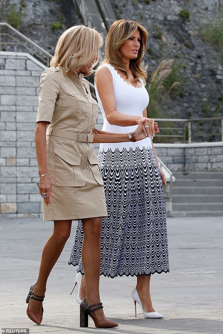 17696960-7394837-Brigitte_was_seen_welcoming_President_Trump_s_wife_Melania_49_wh-a-7_1566822585032