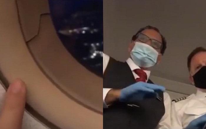 Đang ngồi trên máy bay thì phát hiện cửa sổ bị nứt và đang ...