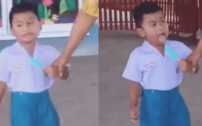 Cậu nhóc tay cầm cây kem mát lạnh mà mãi không cắn ...